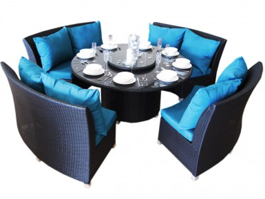 Beautiful bright blue outdoor cushions with black wicker.