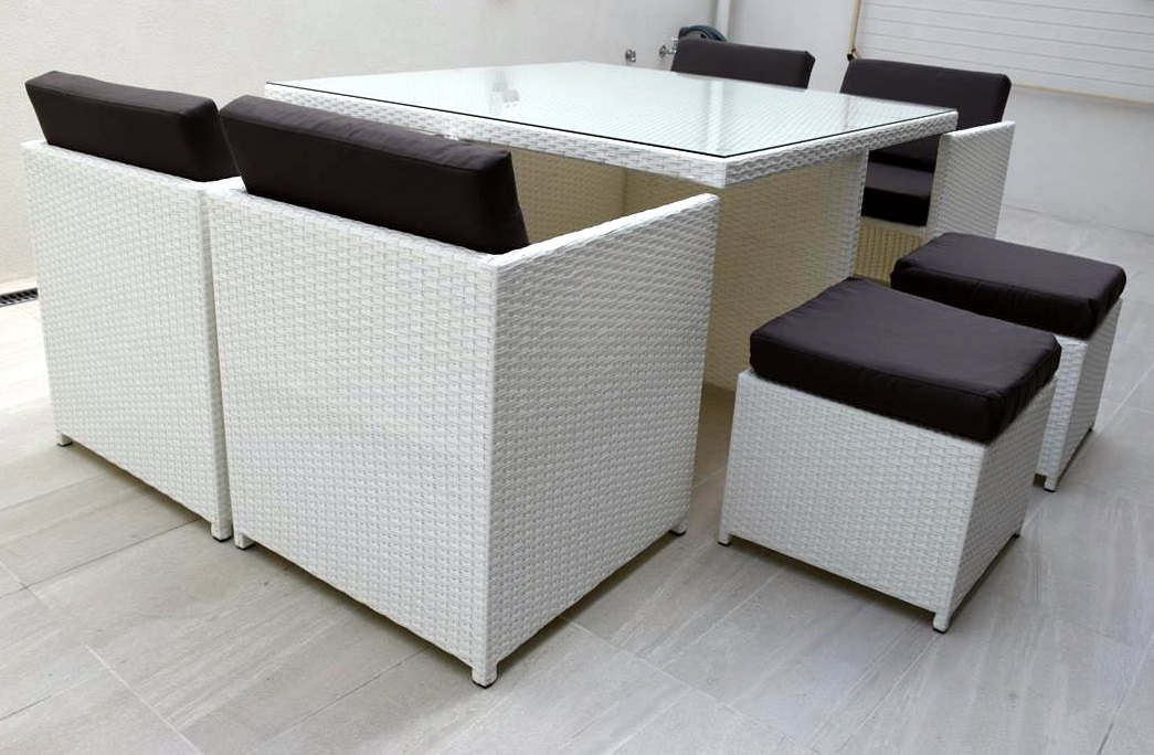 Beautiful White Wicker Outdoor Dining Setting. Compact style that seats eight people.