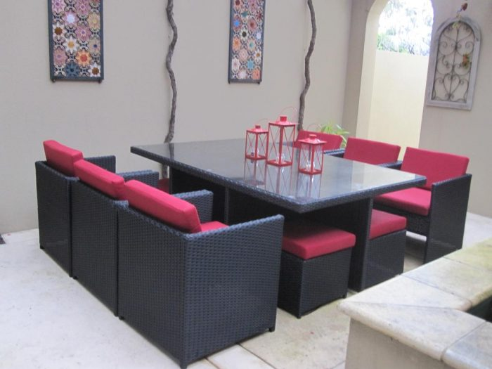 Red outdoor cushions. Black wicker or rattan dining setting in Perth