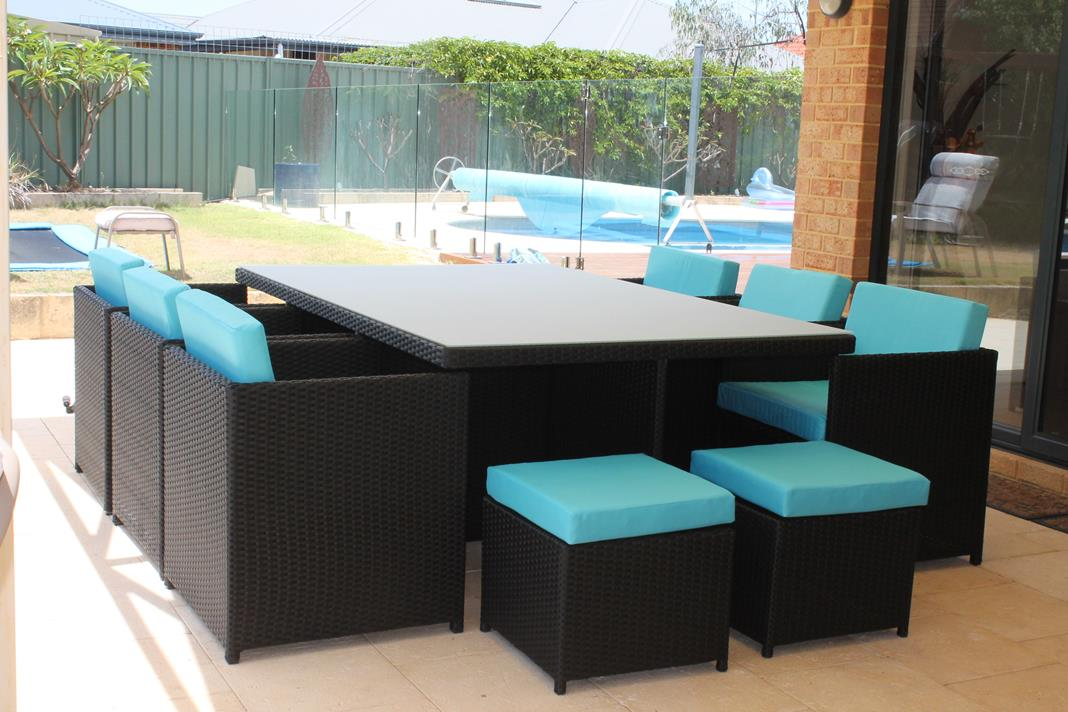 Outdoor Dining Setting with Blue Fabric to Match the Swimming Pool