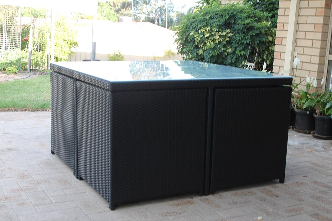 All weather rattan cube style dining setting with tempered glass.