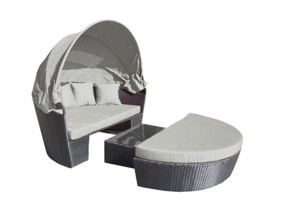 A black wicker day bed with light grey fabric