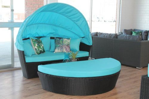 Black all weather wicker with blue fabric. Day bed that pulls apart into a lounge.