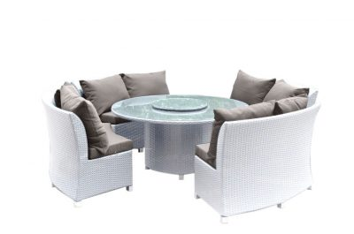A modern white dining set. Round shape, with seating for eight people. Totally weather proof for the Perth sun.