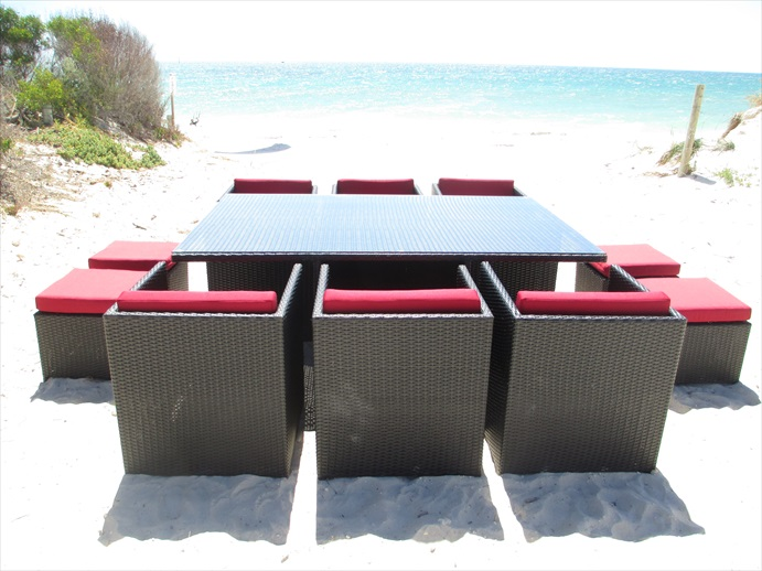 Red cushioned outdoor dining set in Perth, Western Australia. Made of wicker.