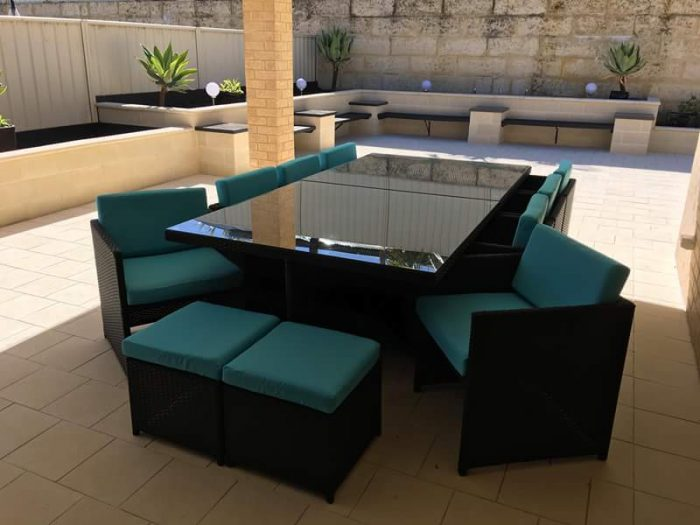 All-weather rattan dining setting in black colour with blue fabric.