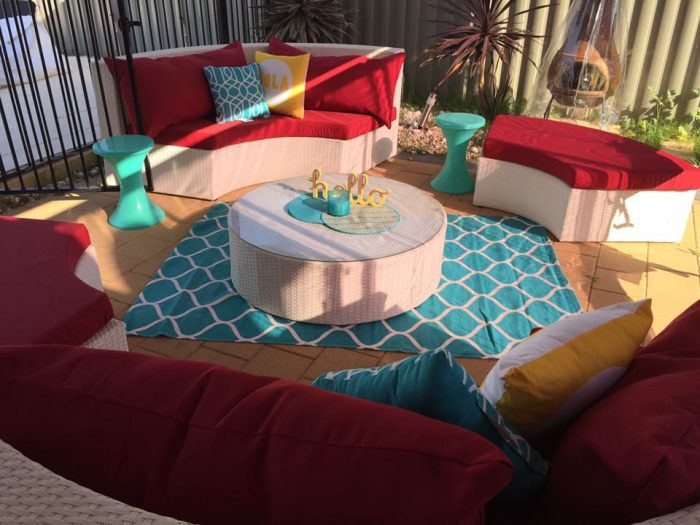 Urbani Furniture specialises in modern and contemporary all-weather wicker outdoor furniture. This is the circular Olympia Suite with white wicker and red fabric.