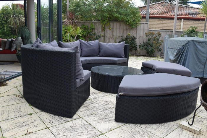 A contemporary round sofa by the pool. Affordable garden furniture.
