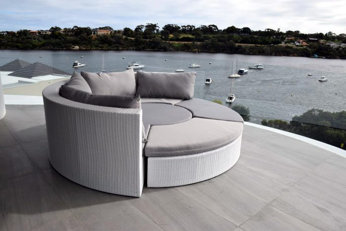 All-weather patio furniture for Perth in white wicker. A round outdoor lounge setting that pushes together to make a day bed.