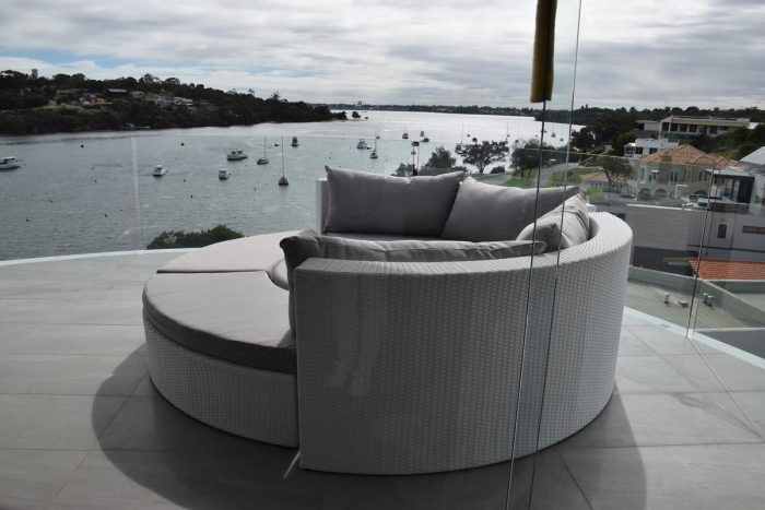 A round lounge for outdoors in white wicker. We specialise in white outdoor furniture for Perth.
