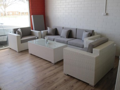 A white wicker lounge setting for the garden. Made of PE rattan. Furniture that is only available in Perth.