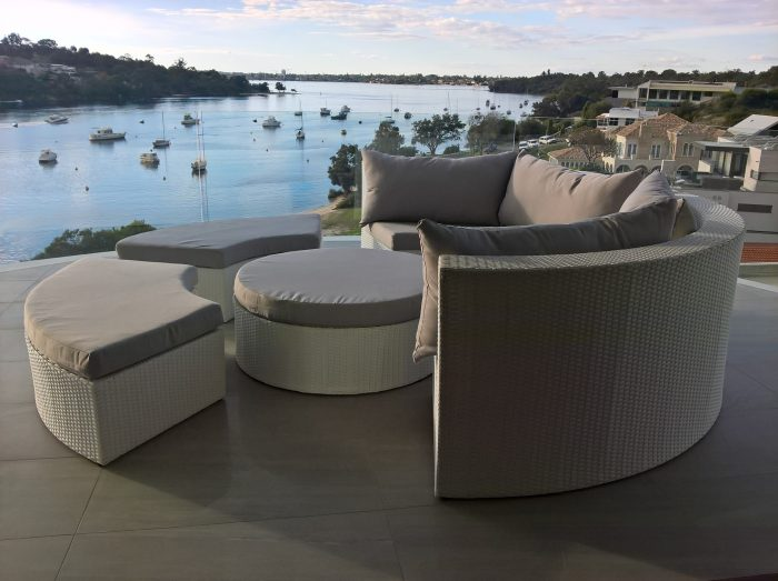 A white wicker, round outdoor lounge setting in Perth. Made of white, all weather PE rattan.