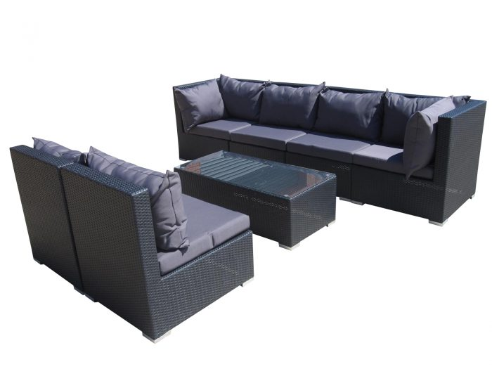 A 7 piece sofa setting in Perth, made of outdoor rattan or wicker.