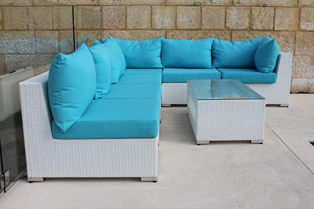 White outdoor furniture for Perth. Made of all-weather white rattan, with blue fabric. A modular lounge setting with a coffee table.