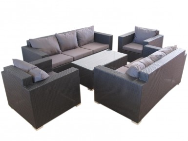 Large and expansive lounge setting with three seat sofa, and two seat lounge. Also an outdoor wicker coffee table with tempered glass.