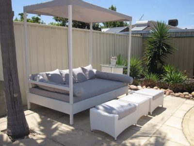 A gorgeous white lounge made of wicker for outdoors.