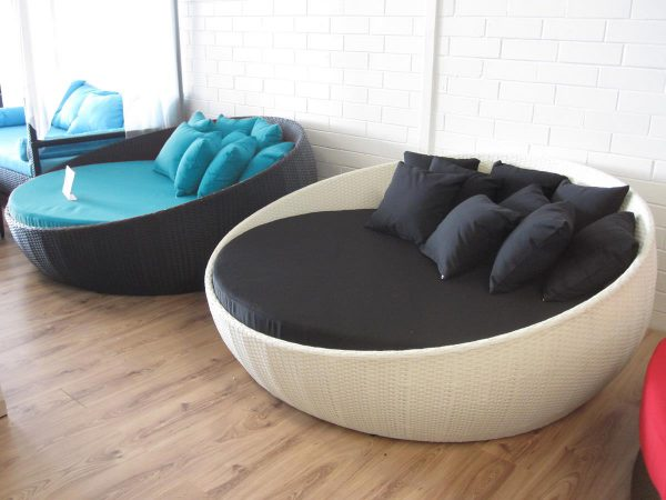 Settee with blue cushion for the outdoors.
