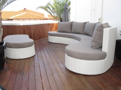 Simply stunning outdoor wicker modular set. All weather rattan on this sofa.