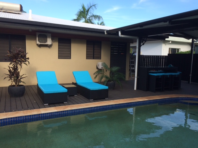 All-weather wicker black sunbed setting with stylish blue fabric by the poolside in Perth.