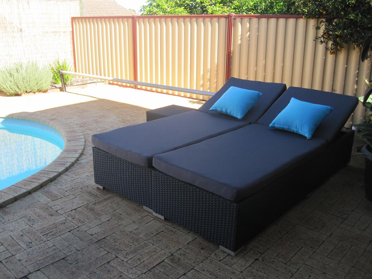 Modern sunbed setting that can form a daybed when pushed together. High quality and affordable wicker outdoor furniture for Perth.