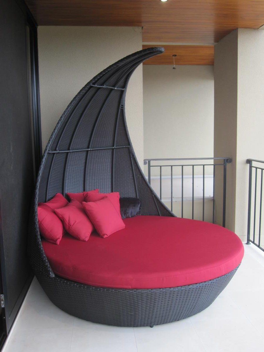 Outdoor Wicker Furniture. A daybed made to take your breath away. Round shape. Black wicker with red cushion. Only for Perth.