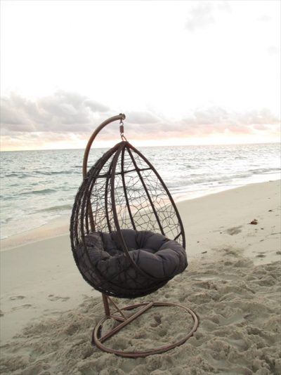 Beautiful hanging chair in a round shape for the garden
