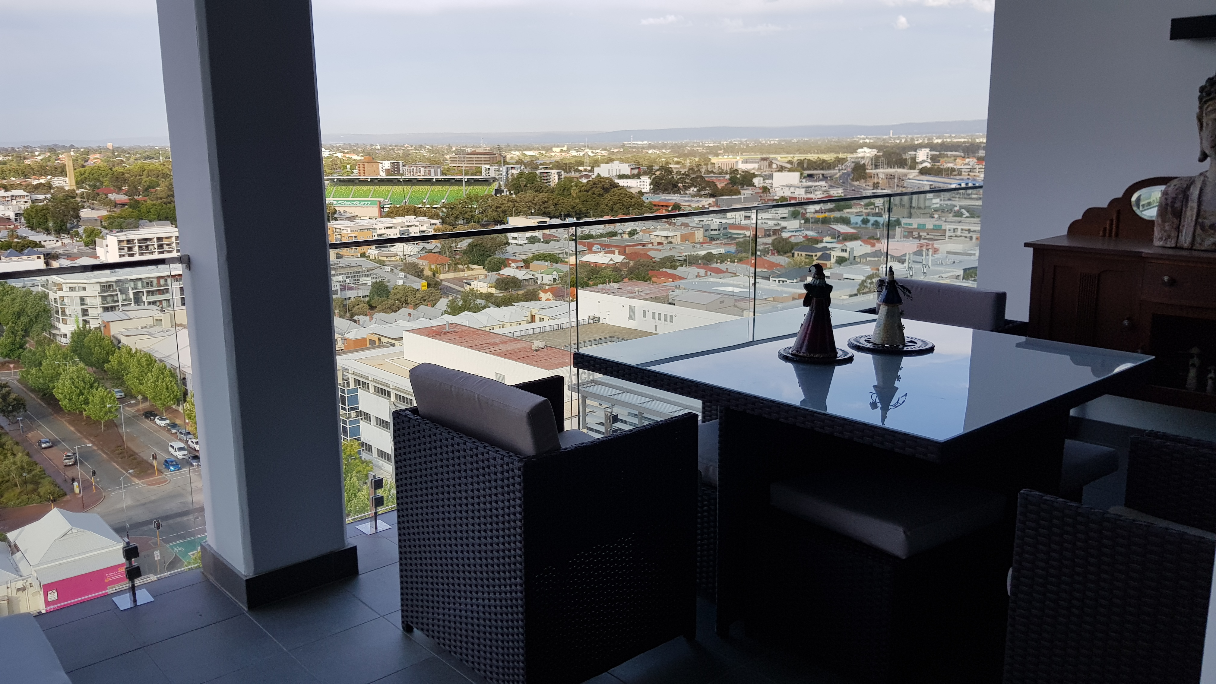 Compact outdoor wicker dining setting on an apartment balcony in Perth