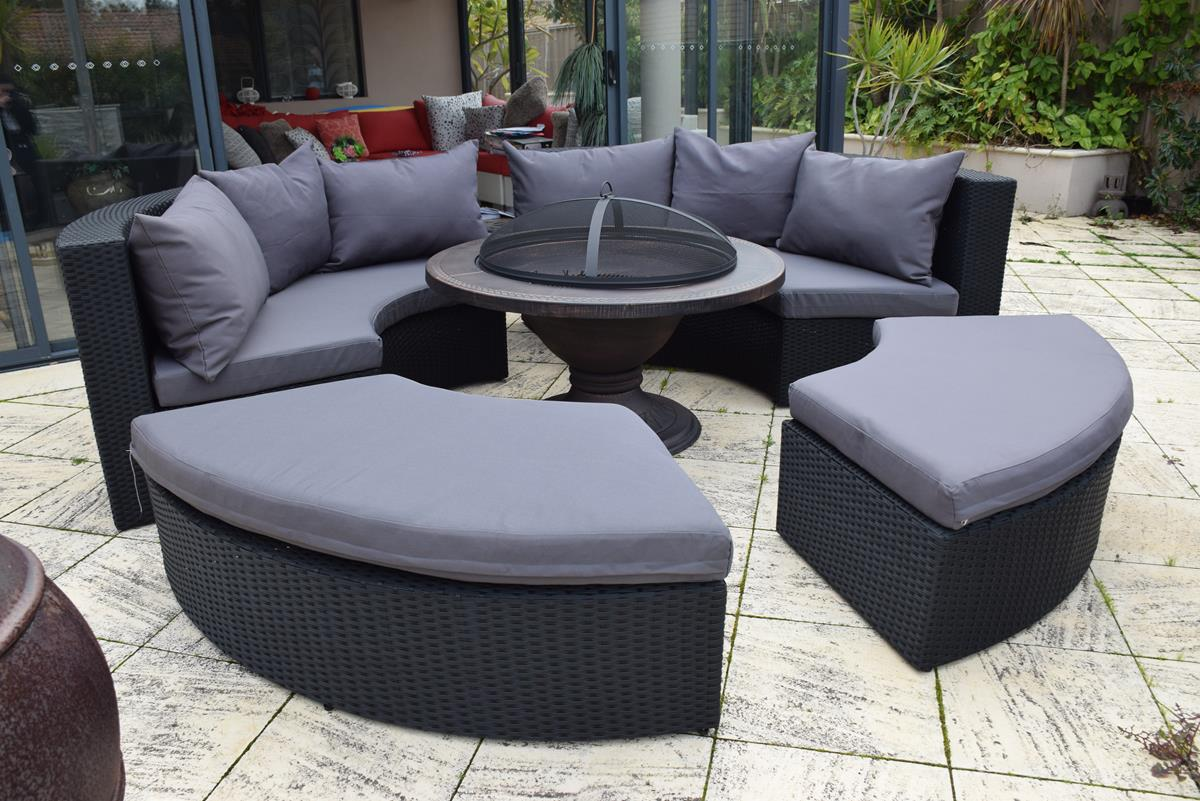The beautiful round Olympia outdoor sofa. A circular shape with black rattan and grey fabric. Made for Perth.