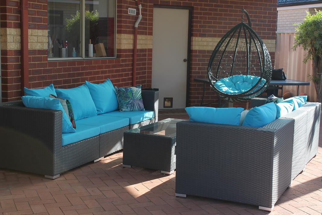 Outdoor Wicker Lounge Setting in a Modern Blue Colour Fabric with Black Wicker. Couch for Outside and a Hanging Chair in Perth.